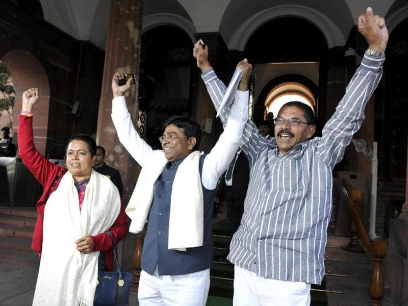 Telangana MPs Gunda Sudharani, Nageshwar Rao, and Ramesh Rathore celebrate the passage of Telangana bill in the Lok Sabha. (HT Photo/Sonu Mehta)