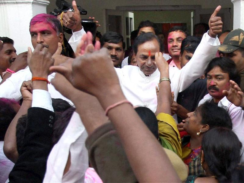 TRS chief K Chandrasekhar Rao with supporters celebrating the passage of Telangana bill in the Lok Sabha, at his residence in New Delhi. (PTI photo)