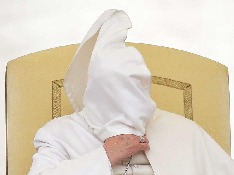 The gust caught Pope Francis off guard at the general audience in St Peter's square at the Vatican. (AFP photo)