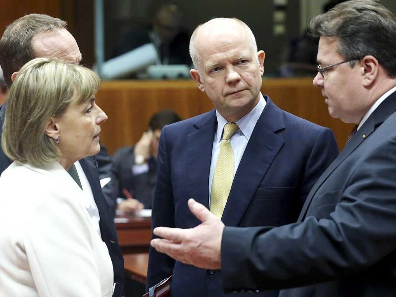 British foreign secretary William Hague listens to Croatia's foreign minister Vesna Pusic (L) and Lithuania's foreign minister Linas Linkevicius (R) during an emergency meeting of EU foreign ministers on Ukraine, at the EU Council in Brussels. (Reuters)
