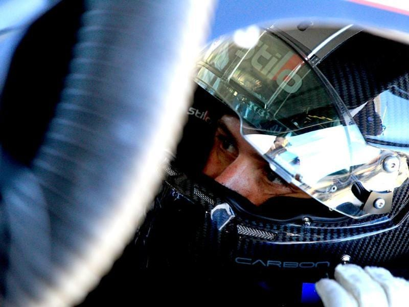 Brian Scott, driver of the #2 Shore Lodge Chevrolet, sits in his car in the garage area during practice for the NASCAR Nationwide Series DRIVE4COPD 300 at Daytona International Speedway (AFP photo)