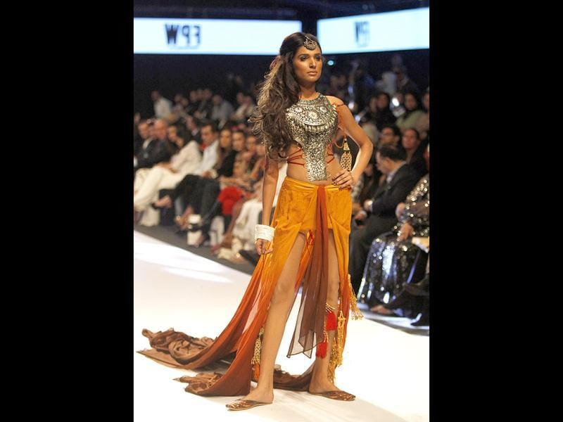 A Pakistani model presents a creation by designer Adel Emmanucl, on the first day of Fashion Pakistan Week, in Karachi. (AP)
