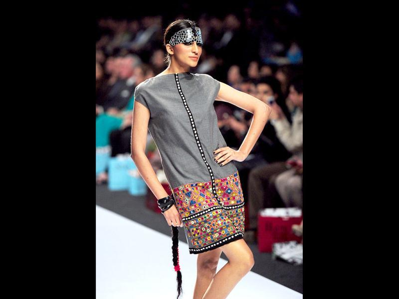 A Pakistani model presents a creation by designer Inaya on the second day of Fashion Pakistan Week in Karachi. (AFP)