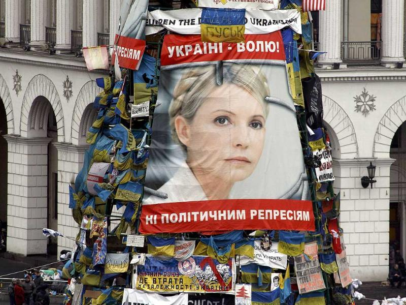 A poster showing jailed Ukrainian opposition leader Yulia Tymoshenko is seen in the Independence Square in Kiev. (Reuters Photo)