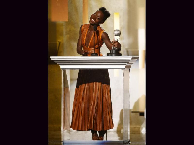 Actress Lupita Nyong'o accepts the outstanding supporting actress in a motion picture award for the film 12 Years a Slave during the 45th NAACP Image Awards in Pasadena, California. (Reuters)