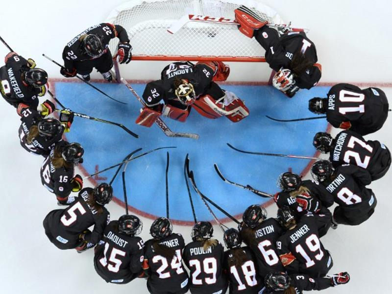 Team Canada gather before the start of the Women's Ice Hockey Group A match against Switzerland at the Shayba Arena at the 2014 Sochi Winter Olympics on February 8, 2014. AFP PHOTO