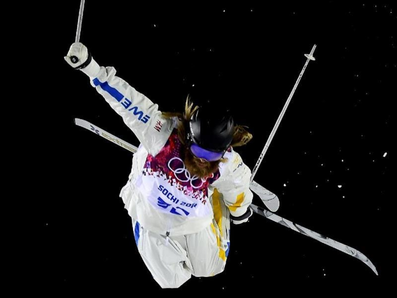 Sweden's Per Spett competes in the Men's Freestyle Skiing Moguls finals at the Rosa Khutor Extreme Park during the Sochi Winter Olympics. AFP PHOTO