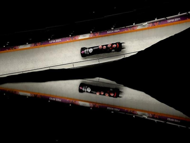 Great Britain-2 four-man bobsleigh, pilot Lamin Deen, pushman John Baines, pushman Andrew Matthews and brakeman Ben Simons compete in the Bobsleigh Four-man Heat 1 at the Sanki Sliding Center during the Sochi Winter Olympics. AFP