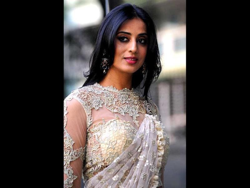 "Mahie Gill poses for a photograph while showcasing a creation by designer Amy Billimoria during a promotional event for her forthcoming film ""Gangs of Ghosts"" in Mumbai on February 24, 2014. (AFP Photo)"