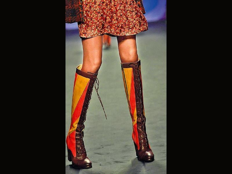 If you want to flaunt the rock-chic look, these knee-length combat boots, seen at Anna Sui's show at New York Fashion Week Fall 2014, are your pick.