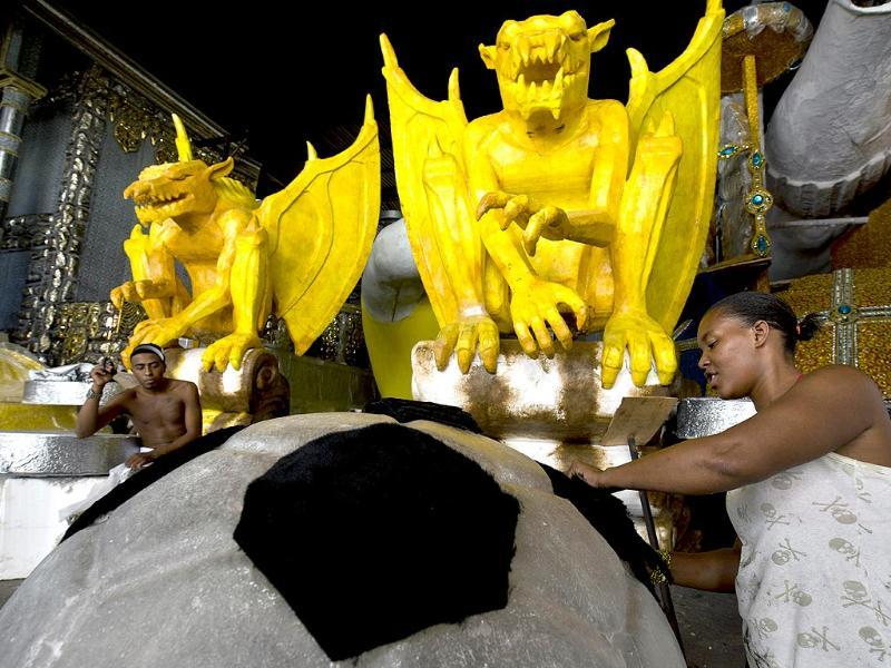 A member of the Gavioes da Fiel samba school works on a float in Sao Paulo, Brazil. Gavioes da Fiel's theme for this year's carnival is an homage to Brazilian former football star Ronaldo. (AFP photo)