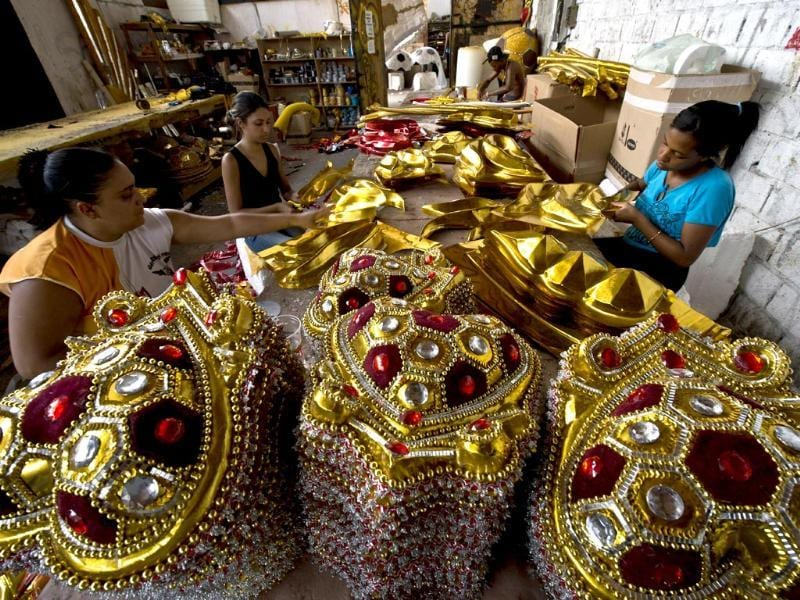 Members of the Gavioes da Fiel samba school work on costumes in Sao Paulo, Brazil. Gavioes da Fiel's theme for this year's carnival is an homage to Brazilian former football star Ronaldo.(AFP photo)