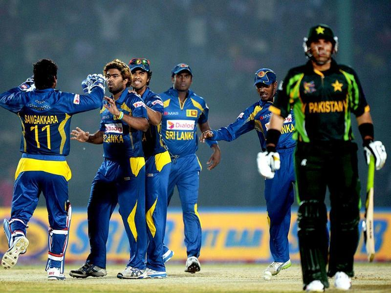 Sri Lankan cricketers congratulate Lasith Malinga (2L) after he dismissed Pakistani cricketer Misbah-ul-Haq (R) during the opening match of the Asia Cup one-day cricket tournament between Pakistan and Sri Lanka at the Khan Shaheb Osman Ali Stadium in Fatullah, on the outskirts of Dhaka. AFP