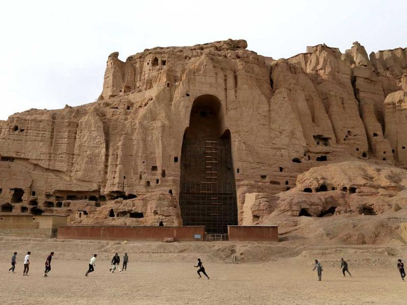 Afghan boys play football in front of the empty seat of one of two 2000-year-old Buddha statues that were destoryed by the Taliban in 2001 in Bamiyan province (AFP photo)
