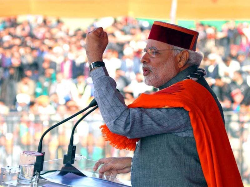 Gujarat CM and PM candidate of BJP Narendra Modi addresses a public rally at Sujanpur. (PTI Photo)