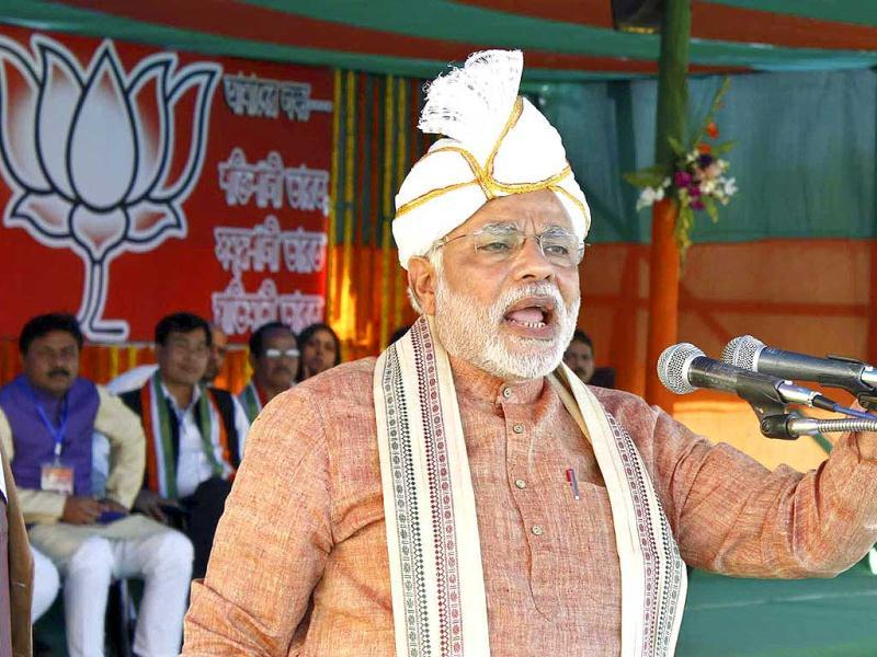 Gujarat's chief minister Narendra Modi wearing a turban addresses his supporters during a rally in Assam. (Reuters Photo)