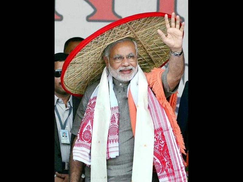 "BJP Prime Ministerial candidate Narendra Modi during the ""Mahajagaran Rally"" in Guwahati. (PTI Photo)"