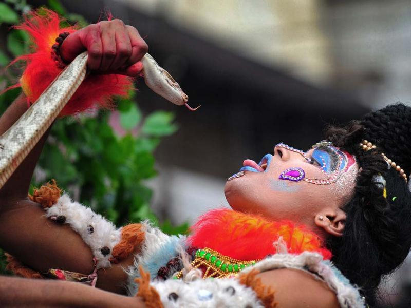 A Hindu devotee holds a python during a procession for Maha Shivaratri, dedicated to Lord Shiva, in Allahabad. (AFP Photo)