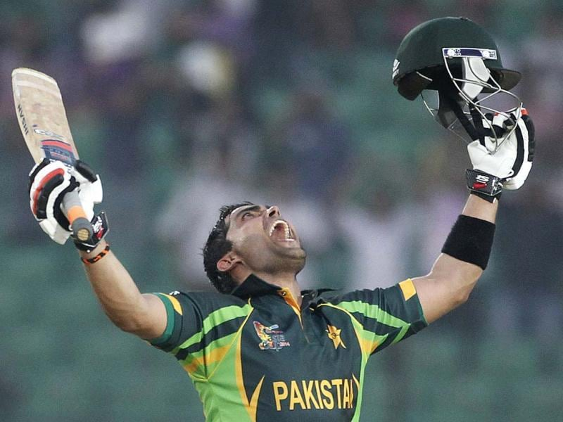 Pakistan's Umar Akmal celebrates after scoring a century against Afghanistan during their Asia Cup 2014 match in Fatullah. (Reuters Photo)