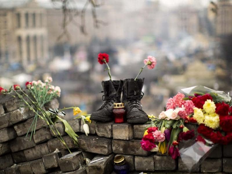 A pair of boots sits on top of a barricade at the Independence Square in Kiev, Ukraine. (AP Photo)