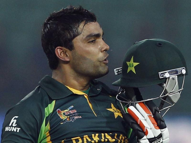 Pakistan's Umar Akmal kisses his helmet after scoring a century during the Asia Cup match against Afghanistan in Fatullah, Bangladesh. (AP Photo)