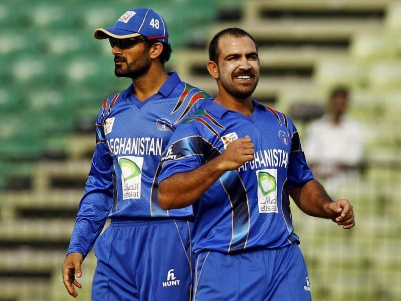 Afghanistan's Samiullah Shenwari (R) celebrates the wicket of Pakistan's Ahmed Shehzad during their Asia Cup match in Fatullah, Bangladesh. (AP Photo)