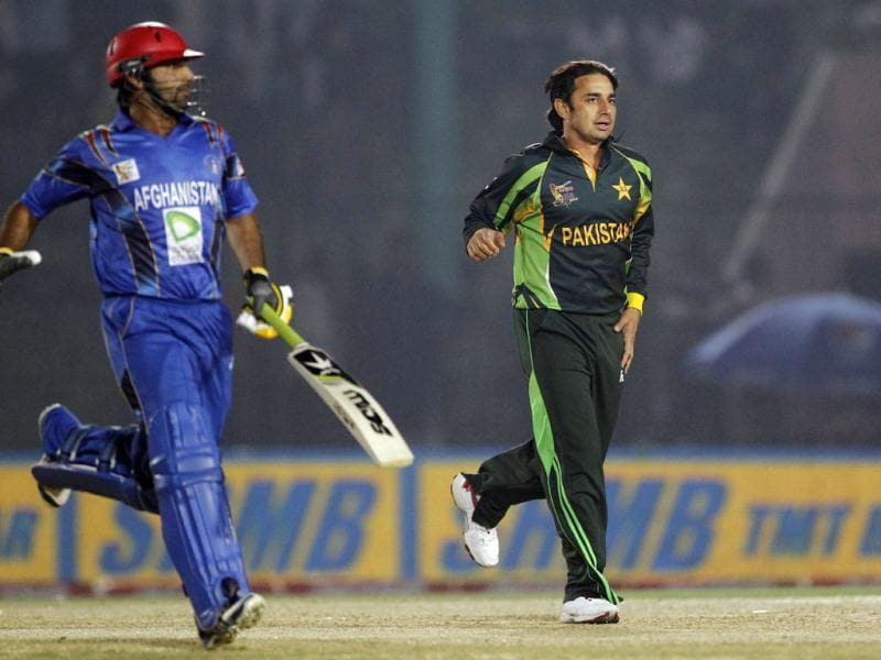 Pakistan's Saeed Ajmal (R) celebrates after taking the wicket of Afghanistan's Noor Ali Zadran during their Asia Cup match in Fatullah. (AP Photo)