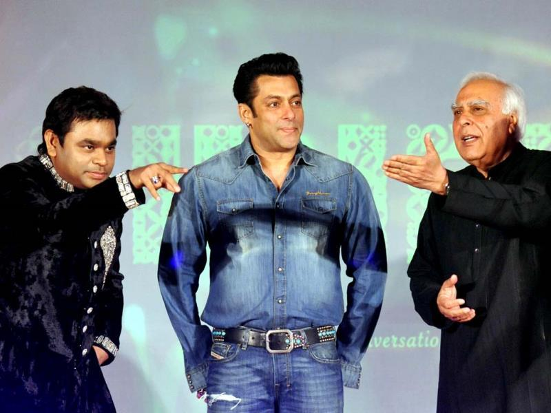 Bollywood actor Salman Khan is flanked by composer AR Rahman and Union Law Minister Kapil Sibal during the launch of the music album Raunaq, a collaboration between Rahman and Sibal, in Mumbai. (AFP)