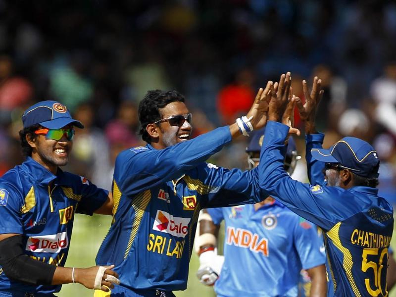 Sachithra Senanayake (C) celebrates with his teammates taking the wicket of India's Rohit Sharma during the Asia Cup in Fatullah. (AP Photo)