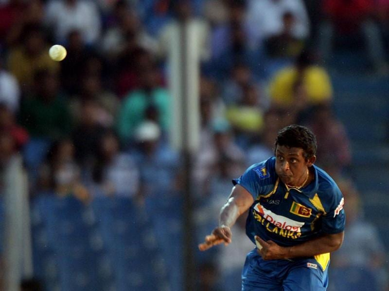 Sri Lankan bowler Ajantha Mendis delivers a ball during the fourth match of the Asia Cup one-day cricket tournament against India at the Khan Shaheb Osman Ali Stadium in Fatullah. (AFP Photo)