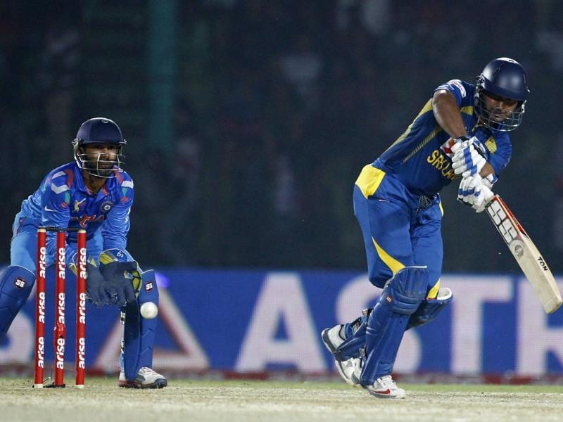 Sri Lanka's Kumar Sangakkara plays a shot during the Asia Cup match against India in Fatullah. (AP Photo)