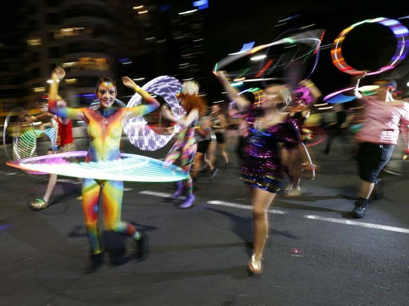 Participants dance with hula hoops during the 2014 Sydney Gay and Lesbian Mardi Gras parade. (Reuters Photo)