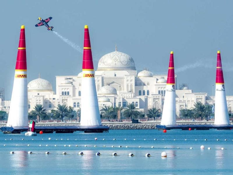 Peter Besenyei of Hungary performs in front of the Presidential Palace during a training session for the first stage of the Red Bull Air Race World Championship in Abu Dhabi. (AFP Photo)