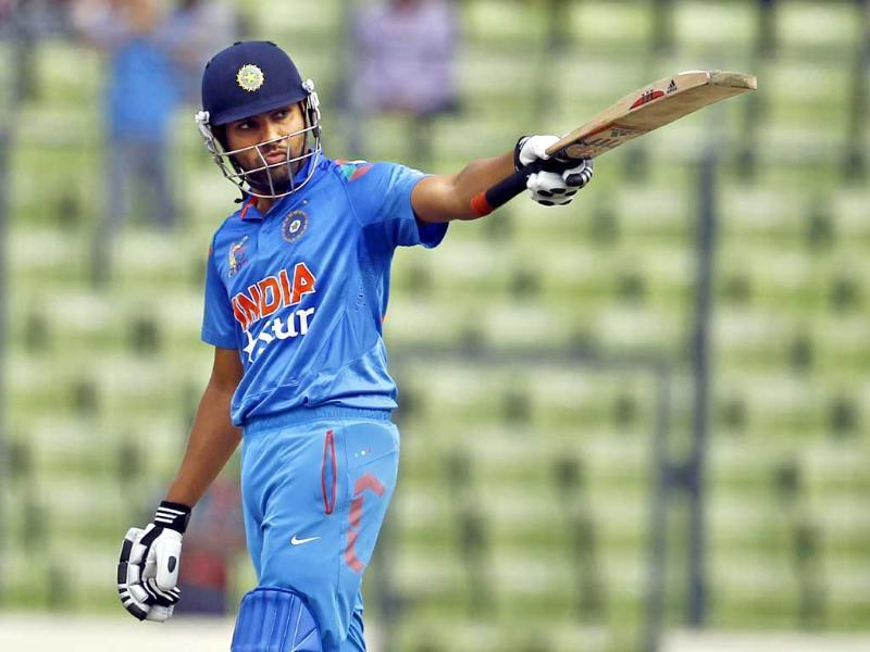 Rohit Sharma raises his bat after scoring fifty against Pakistan during their Asia Cup match in Mirpur. (AP Photo)