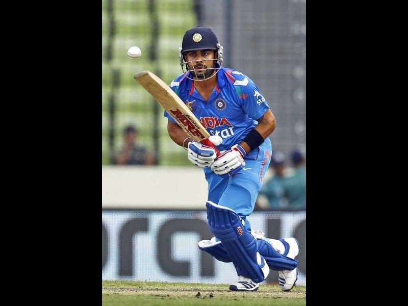 Virat Kohli plays a shot during the Asia Cup match against Pakistan in Mirpur. (AP Photo)