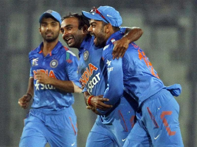 Amit Mishra (C) celebrates with teammates after taking the wicket of Pakistan's Umar Akmal during the Asia Cup match in Mirpur. (AP Photo)