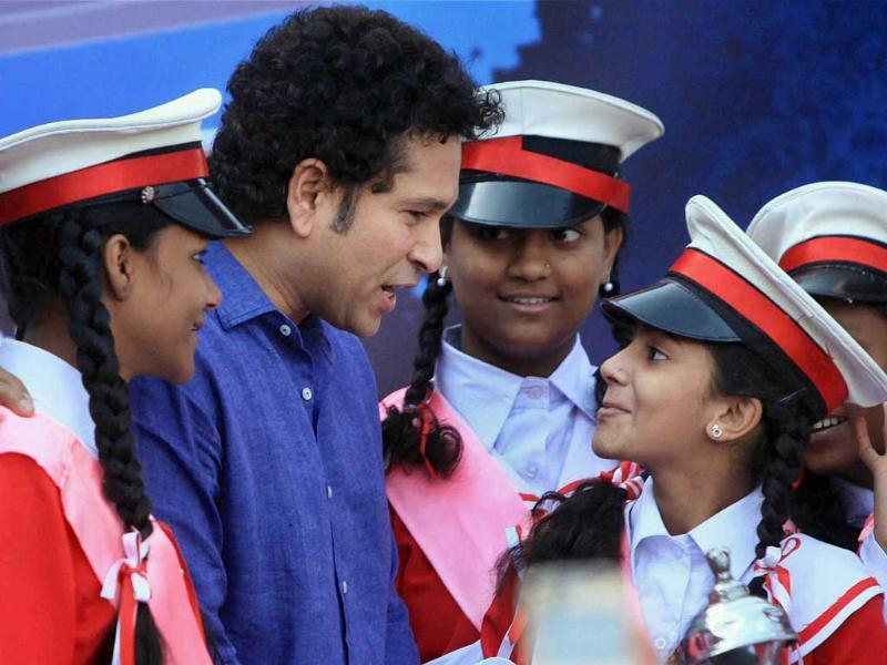 Sachin Tendulkar interacts with children at the unveiling ceremony of the monument 'Bat of Honour' in Mumbai. (PTI photo)