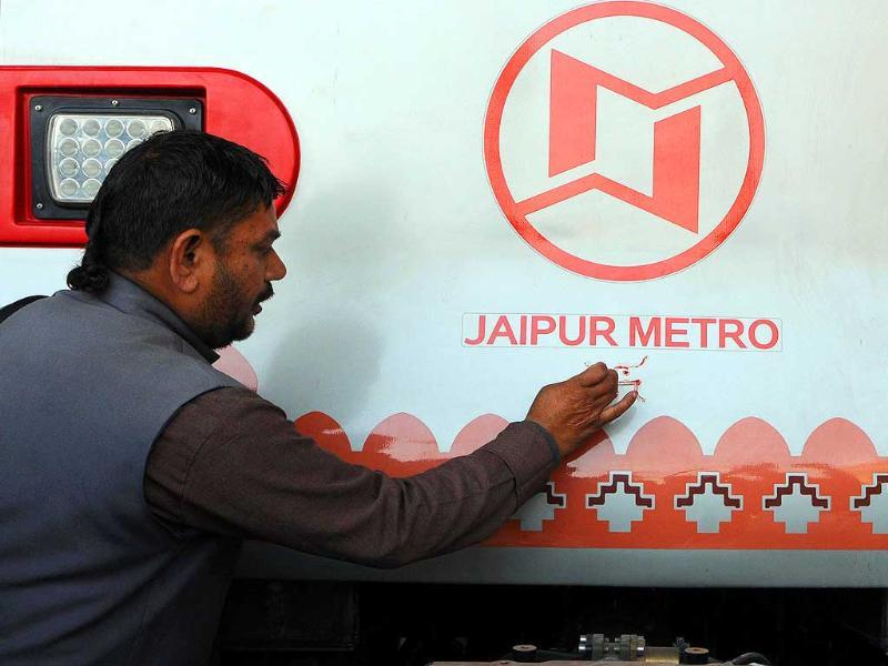 A priest draws the sacred symbol of 'swastik' on Jaipur Metro's coach prior to its first Test-run in Jaipur. (HT photo/Himanshu Vyas)