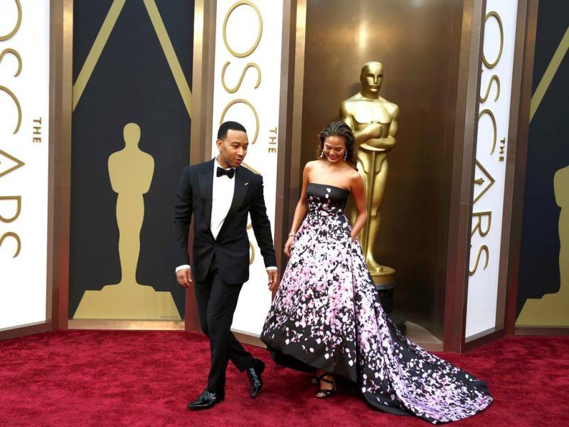 Singer John Legend and model Chrissy Teigen arrive at the 86th Academy Awards in Hollywood, California March 2, 2014. (Reuters Photo)