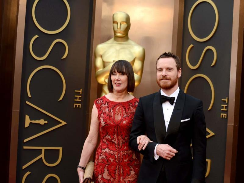 Adele Fassbender and Michael Fassbender arrive at the Oscars on Sunday, March 2, 2014, at the Dolby Theatre in Los Angeles. (AP Photo)