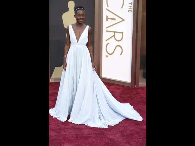 Lupita Nyong'o, nominated for best supporting actress for her role in 12 Years a Slave, arrives before the 86th Academy Awards at the Dolby Theatre in Los Angeles, March 2, 2014. (The New York Times)