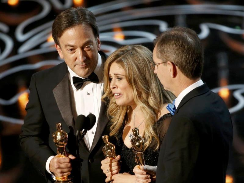 Peter Del Vecho, Jennifer Lee and Chris Buck accept the Oscar for best animated feature film for Frozen.