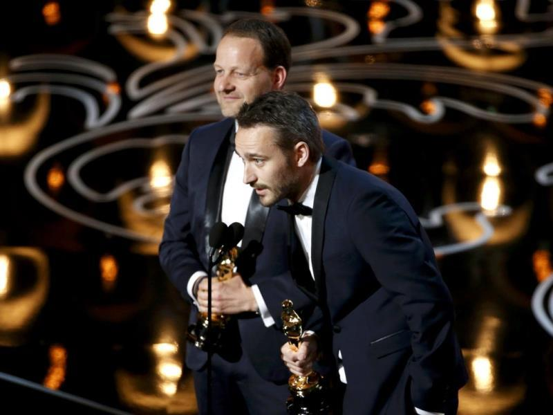 Kim Magnusson and Anders Walter accept the Oscar for best live action short film for Helium.