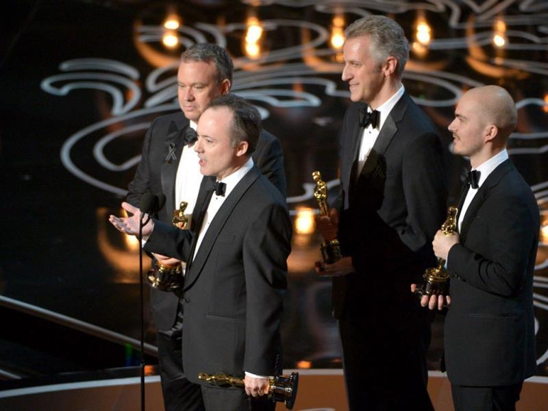Neil Corbould, Tim Webber, David Shirk, and Chris Lawrence accept the award for best visual effects for Gravity.