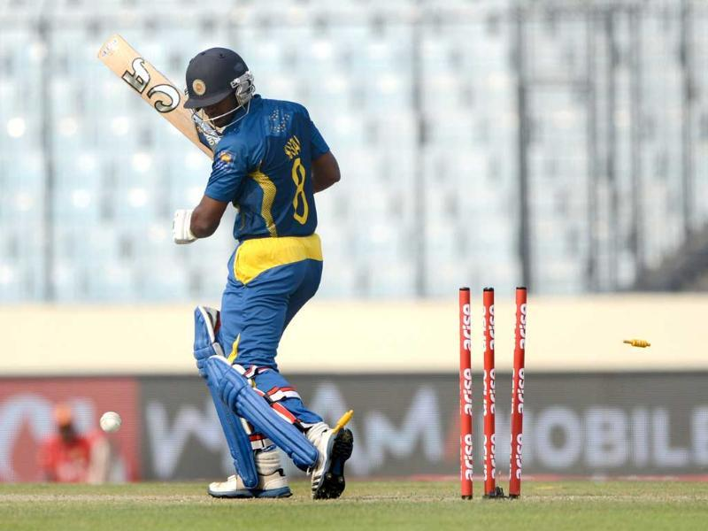 Sri Lankan cricketer Kusal Perera looks back after losing his wicket during the seventh match of the Asia Cup against Afghanistan at the Sher-e-Bangla National Cricket Stadium in Mirpur. (AFP Photo)