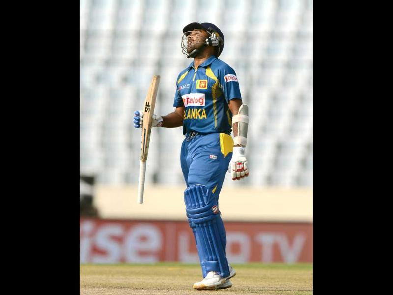 Sri Lankan cricketer Mahela Jayawardene reacts after being dismissed during the seventh match of the Asia Cup against Afghanistan at the Sher-e-Bangla National Cricket Stadium in Mirpur. (AFP Photo)