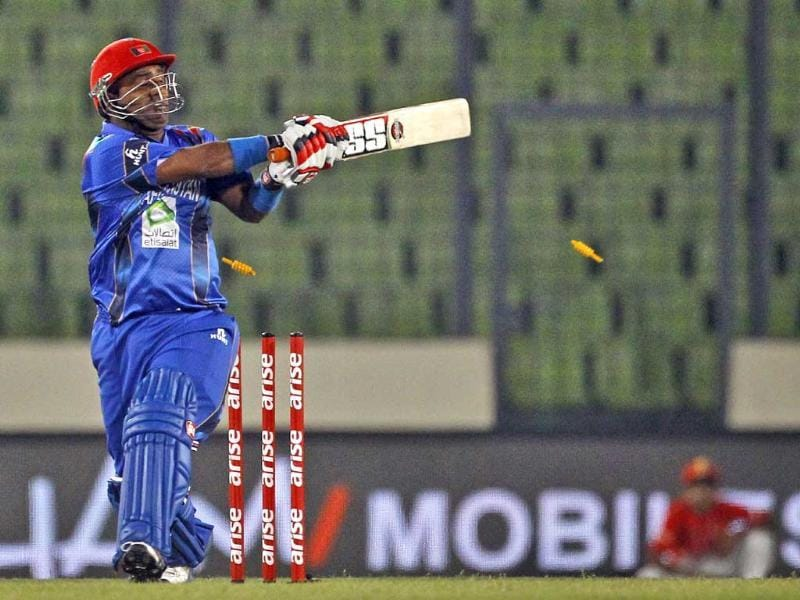 Afghanistan's Mohammad Shahzad is bowled out by Sri Lanka's Suranga Lakmal during their Asia Cup match in Mirpur. (AP Photo)