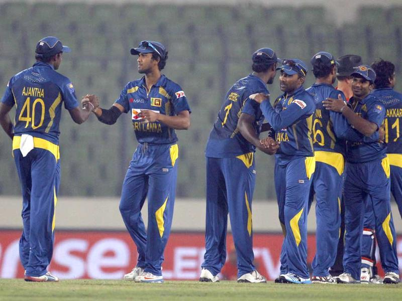 Sri Lankan players celebrate their win over Afghanistan during the Asia Cup match in Mirpur. (AP Photo)