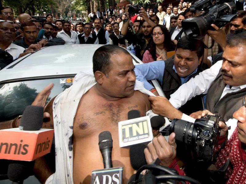 Manoj Sharma (C), who allegedly threw black ink at Sahara group chairman Subrata Roy on his arrival at the Supreme Court, speaks to the media in New Delhi. (AFP Photo)