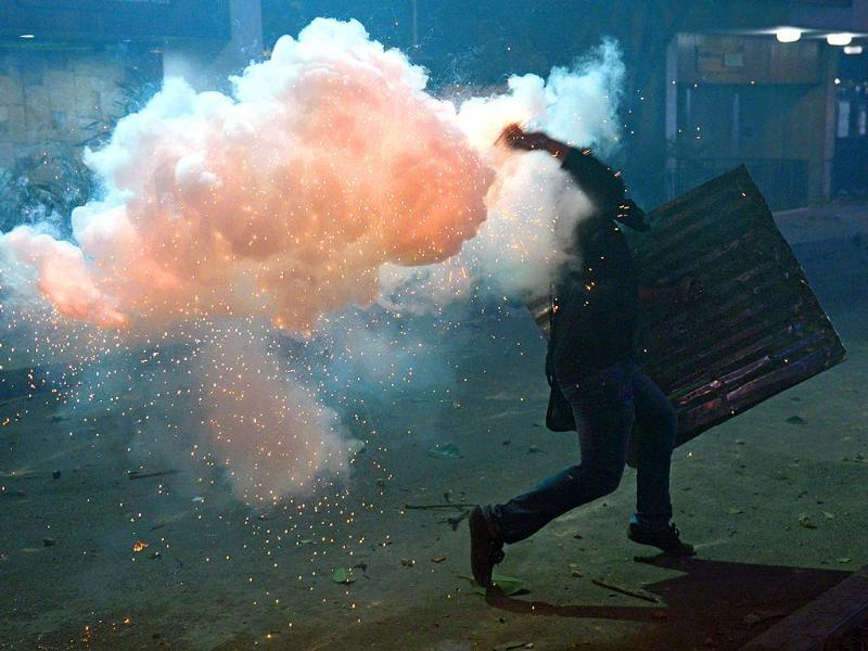 An opposition activists hurls a molotov cocktail at national guard troops during a protest against the government of Venezuelan President Nicolas Maduro, in Caracas. (AFP Photo)
